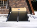Solar geyser on flat roof at Somerset West